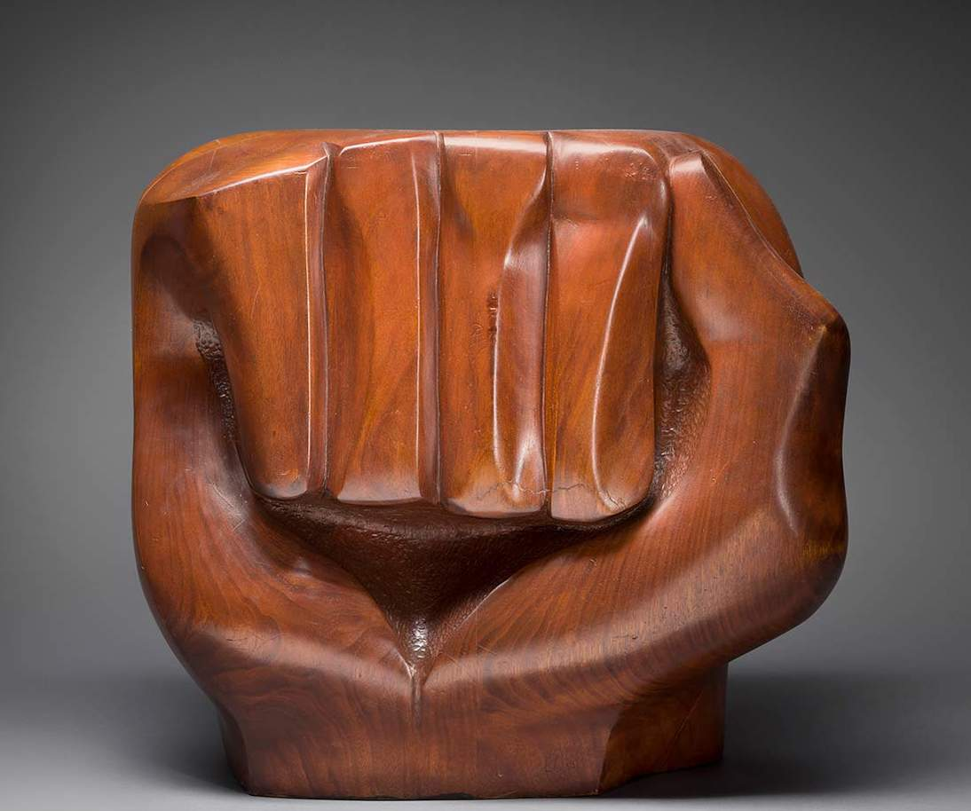 "Elizabeth Catlett, ""Black Unity,"" 1968. Cedar, 21 in. × 12 1/2 in. × 23 in. (53.3 × 31.8 × 58.4 cm). Crystal Bridges Museum of American Art, Bentonville, Arkansas, 2014.11. Photograph by Edward C. Robison III © 2019 Catlett Mora Family Trust / Licensed by VAGA at Artists Rights Society (ARS), NY"