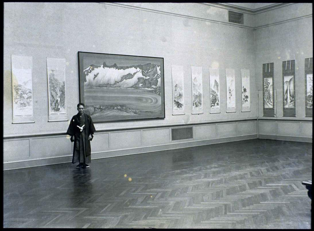 Chiura Obata at his exhibition of paintings by Rokuichi and Chiura Obata at the California Palace of Legion of Honor, 1931. Courtesy of the Obata Family